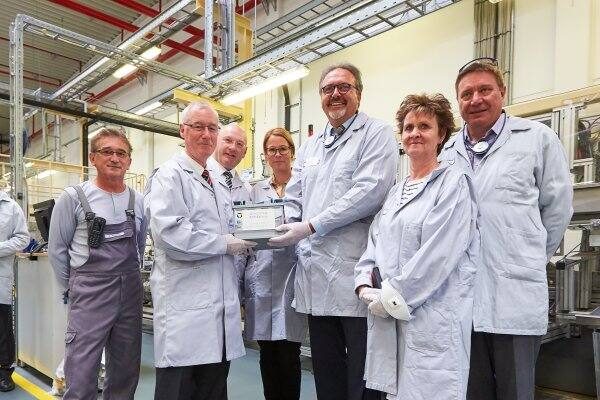 Matthias Horn, plant manager Johnson Controls Sachsen-Batterien GmbH & Co., presents the 40 millionth AGM battery which was produced on May 23, 2017. Pictured from left: Jürgen Ahnert, Matthias Horn, Gerald Otto (member of state parliament Saxony), Franziska Erdle (WV Metalle), Stefan Brangs (State secretary of economics ministry Saxony), Sabine Zimmermann (member of German parliament), Mario Pecher (member of state parliament Saxony).